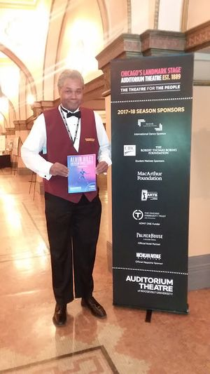 Darryl Maximilian Robinson displays an Alvin Aliey Dance Theatre program in the lobby of the historic Auditorium Theatre in 2018..jpg