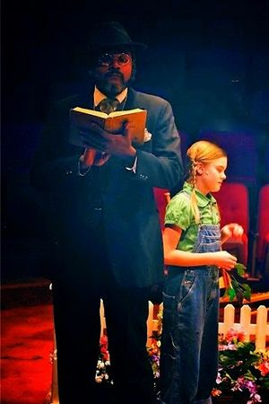 Camille Gibney as Scout Finch and Darryl Maximilian Robinson as The Reverend Sykes in the 2011 Glendale Centre Theatre staging of Harper Lee's To Kill A Mockingbird..jpg