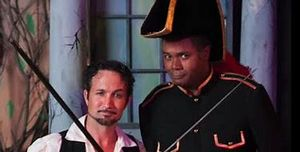 Drew Fitzsimmons as The Pirate King and Darryl Maximilian Robinson as Major-General Stanley in the 2014 San Pedro Theatre Club's The Pirates of Penzance ..jpg