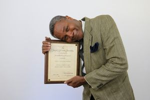 Darryl Maximilian Robinson Embraces His 1997 Chicago Joseph Jefferson Citation Award for Best Actor for Master Harold And The Boys..jpg